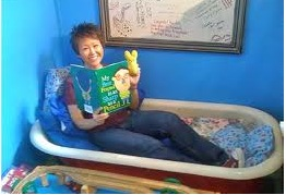 Not every bookstore has a bathtub filled with pillows for reading in.  Here Lisa Yee & friend enjoy this Hickabee's feature
