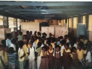 Coulibistrie School, 1990, proud to show off their new shelves for their school books.